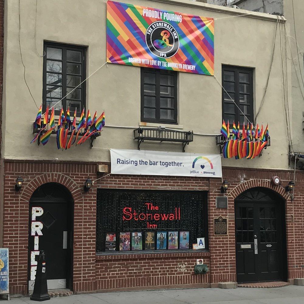 Stonewall Inn, with new Brooklyn Brewery banner.