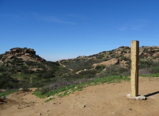 Clearly marked sign on Rocky Peak Trail showing the Hummingbird Trail turnoff