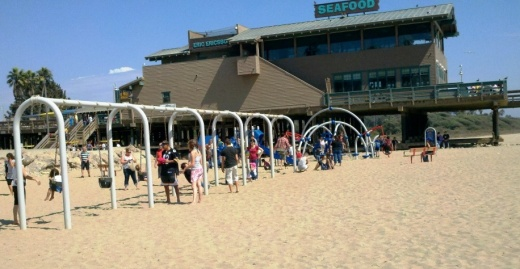 The former Eric Ericsson's (now Beach House Fish) next to the playground on the pier.