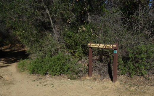 "Sign at the east terminus of Spring Canyon Trail indicating Moorpark Road is half a mile away. Behind me is the trail toward ""Space Mountain"" and Los Robles Trail going east towards Newbury Park."