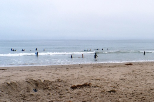 Surfers, boogie boarders, body surfers and frolickers at the Santa Claus Lane area beach.