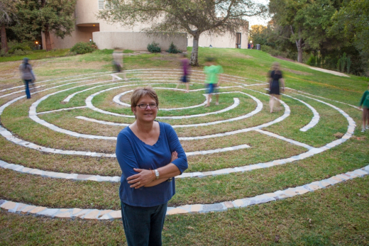 University Pastor Melissa Maxwell-Doherty in front of the labyrinth. (Photo credit: Brian Stethem/CLU)