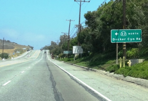 Sign on PCH east of Decker Canyon Road, prior to El Pescador State Beach to the west of it.