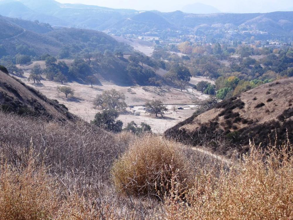 View of the Cheeseboro Canyon trailhead and parking are from the Modelo Spur Trail.