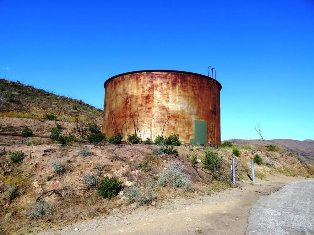 Old water tank seen at the juncture of Ranch Center Road (paved) and Ranch Center Fire Road (trail).