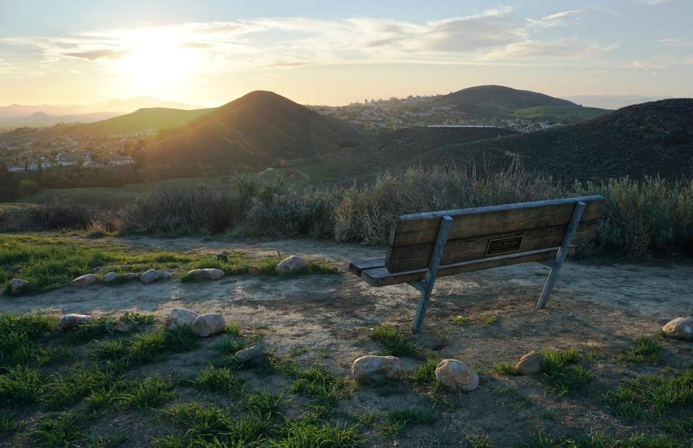 Bench with perfect sunset view off of the Autumn Ridge Trail in the Lang Ranch Open Space.