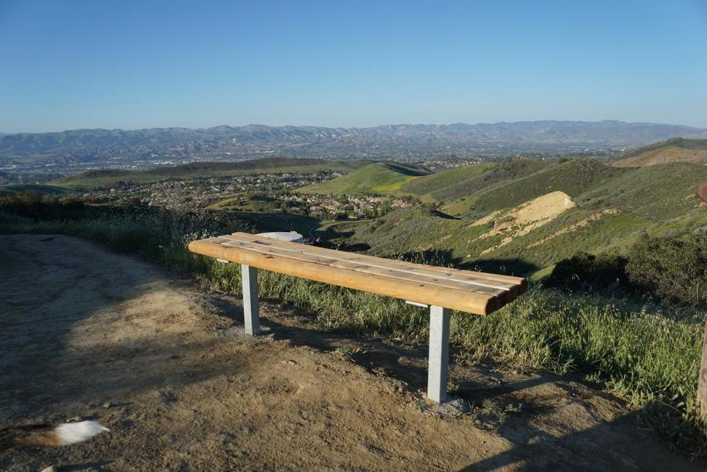 This bench is located at the juncture of the Sunrise and Meadow Vista Trails in the Lang Ranch Open Space and Long Canyon Trail, which is accessible via the Wood Ranch section of Simi Valley. Not a bad view, eh?