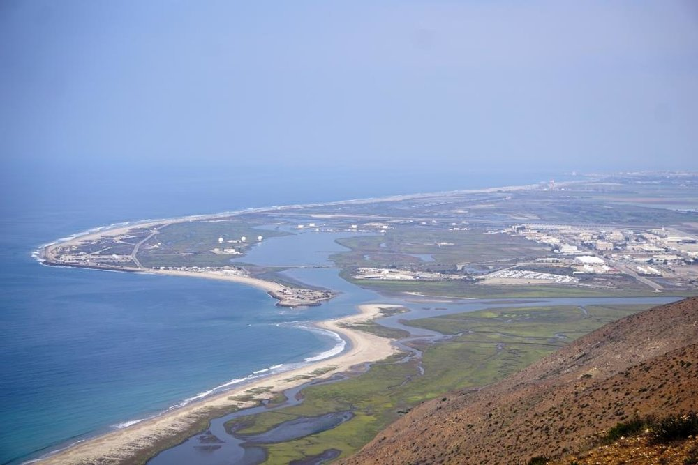 The Mugu Lagoon within Naval Base Ventura County is a colorful sight from throughout the hike and at the top of Mugu Peak.