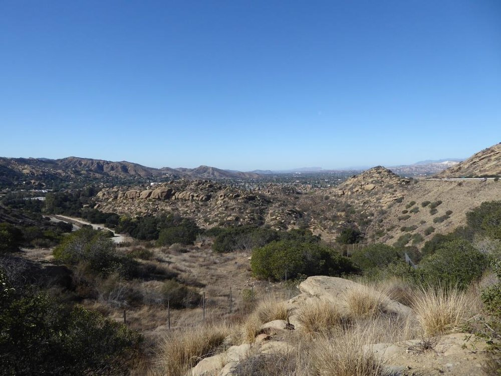 View of Corriganville Park from a trail on the east side of the park. The trail takes you up to 118 Freeway and a wildlife corridor tunnel that takes you under the freeway into Rocky Peak Park.