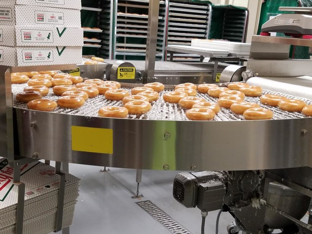 Freshly made doughnuts just a few feet away, tantalizing us.