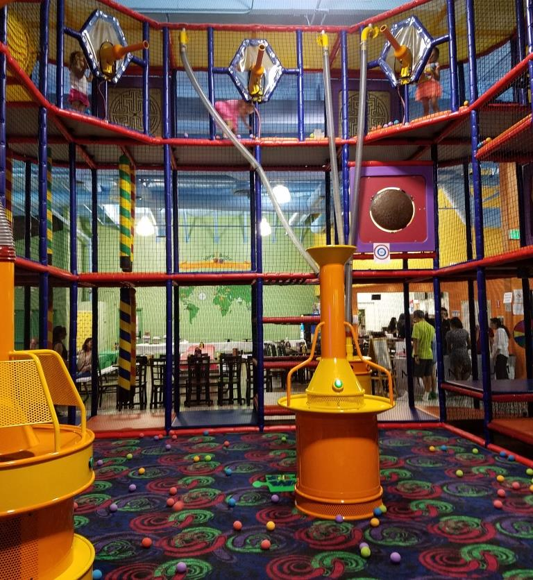 The three story foam ball projectile and climbing area at Kids World in Oak Park