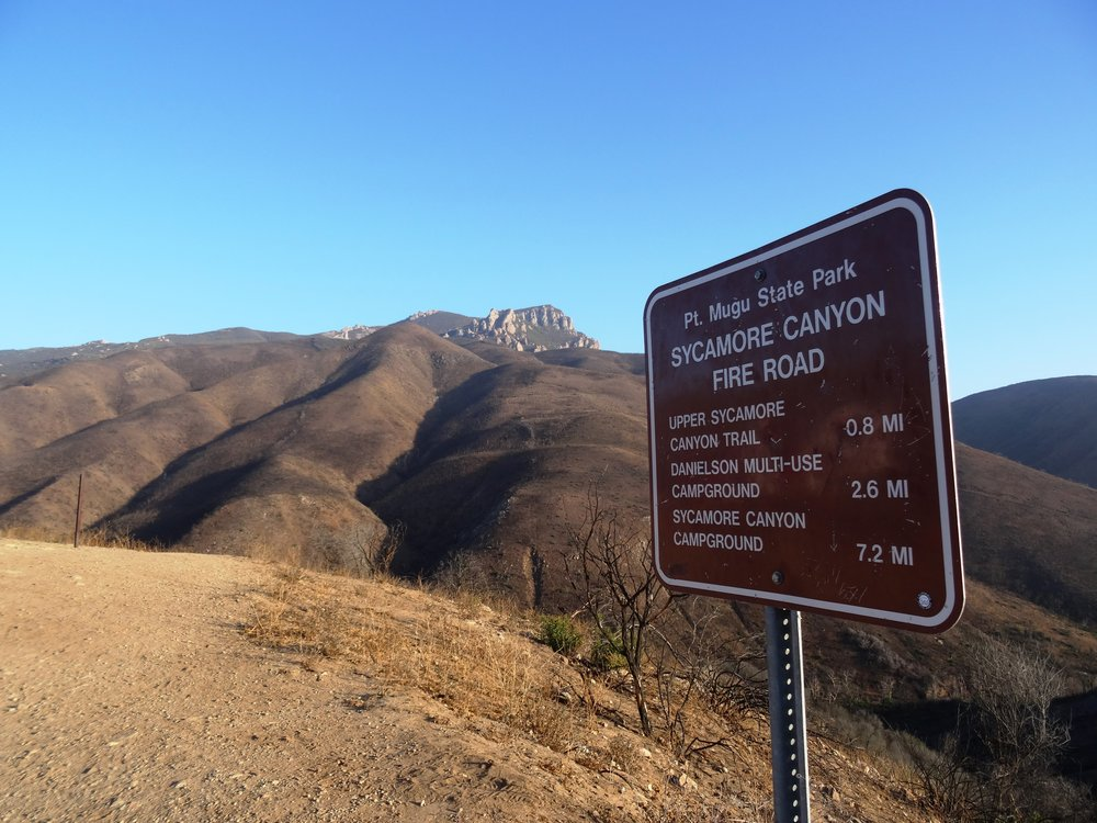 Sign at top of Sycamore Canyon Road before the descent into the canyon.