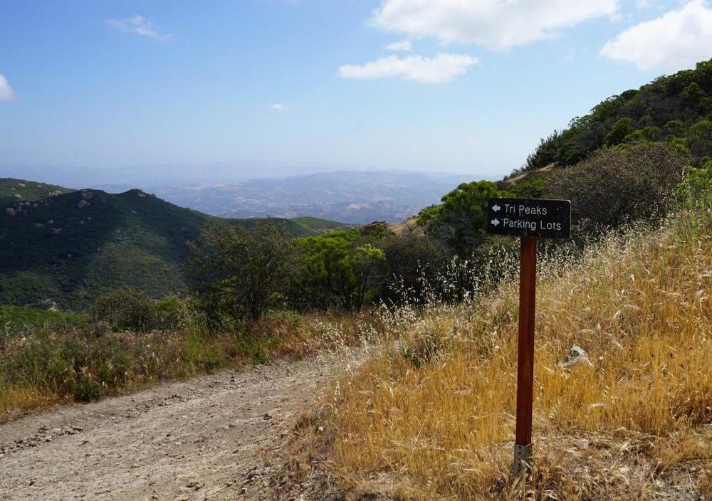 Follow the trail towards Tri Peaks from Sandstone Peak.