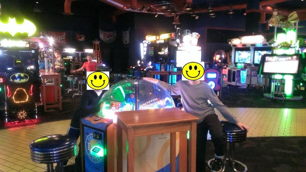 Happy faces on display at the Dave & Busters in Kansas.