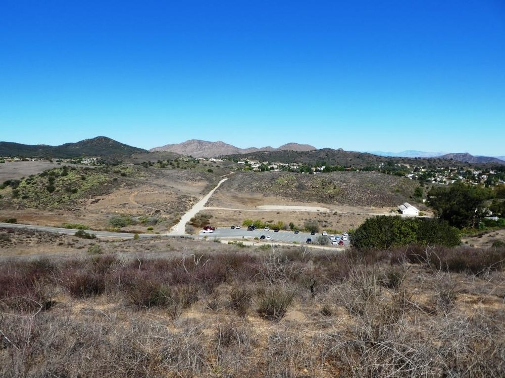 Peak of Ranch Overlook Trail, looking down towards main Rancho Sierra Vista/Satwiwa parking area and restrooms.