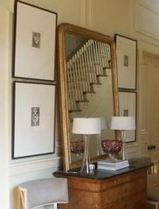 foyer leaning mirror and framed prints
