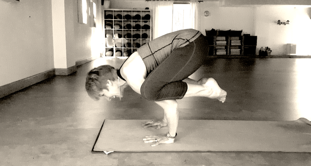 Trina in a beautiful  Bakasana  (Crow Pose)