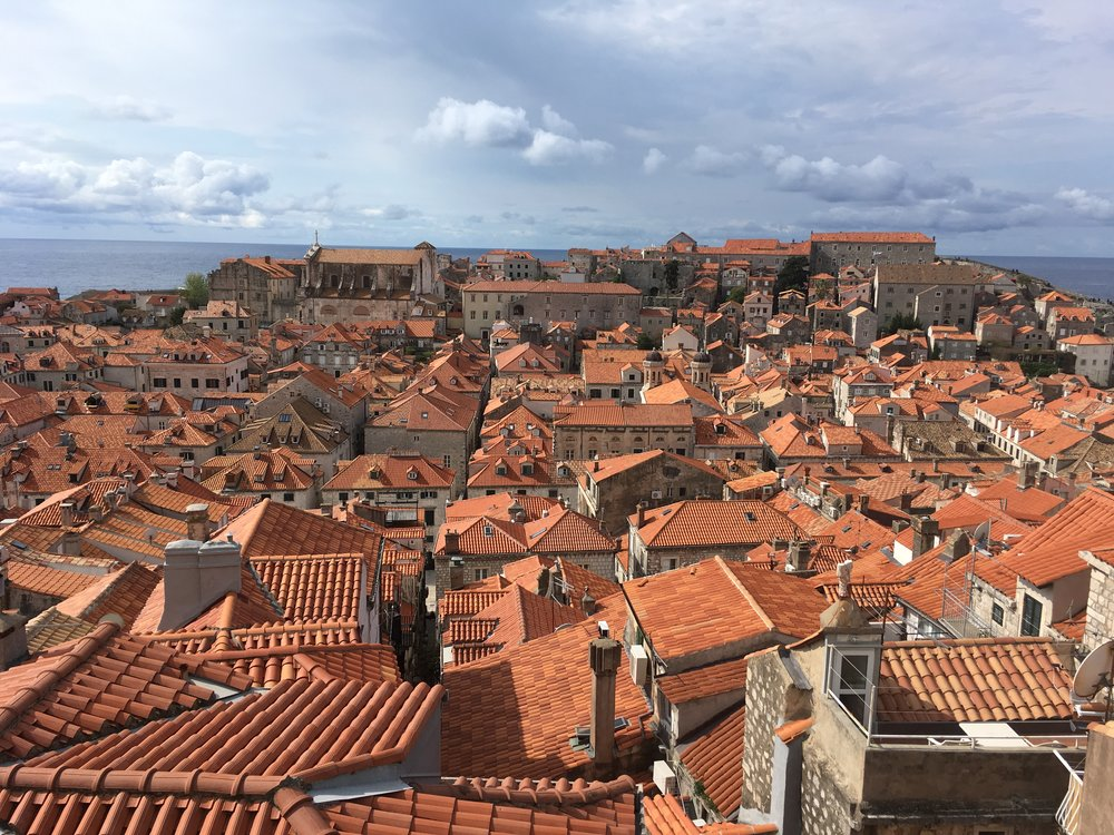 Newer, more orange tiles show the repaired roofs from the Siege of Dubrovnik in the 1990's.