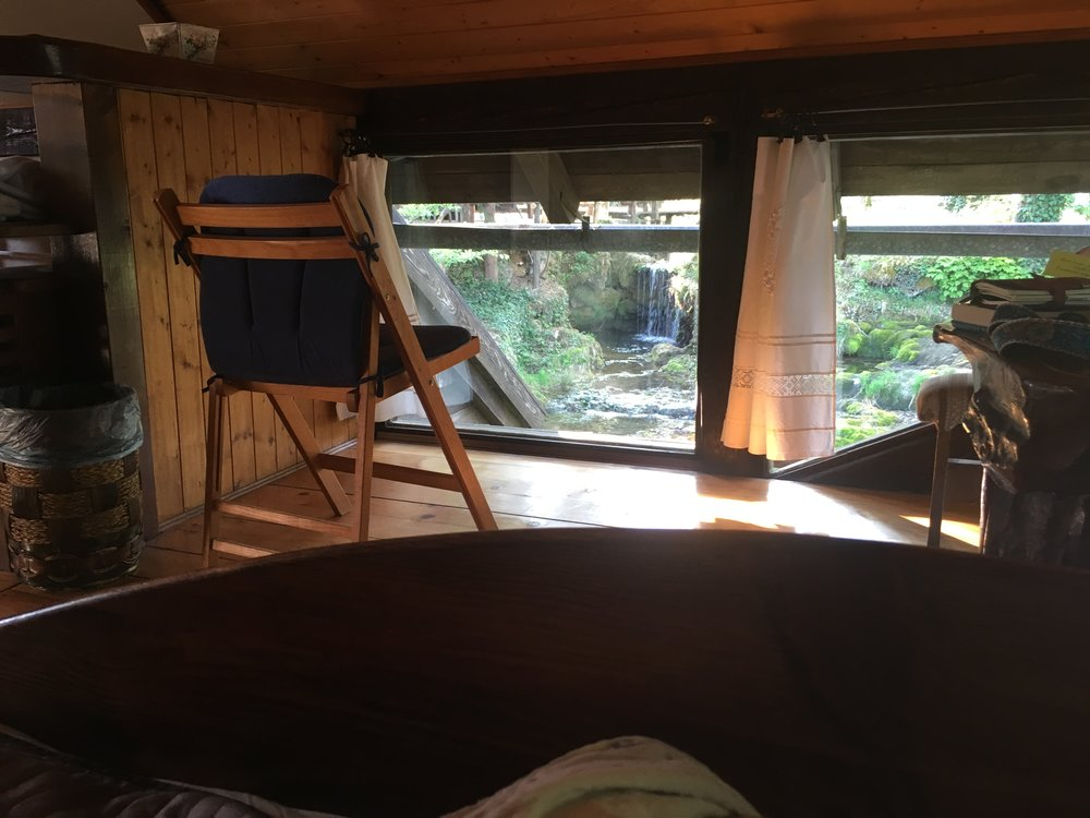 From the bungalow's bed, you can see waterfalls