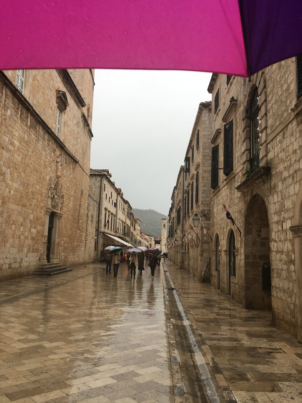 The wet, slippery streets of Dubrovnik - a small umbrella is very useful for Croatia's temperamental weather!