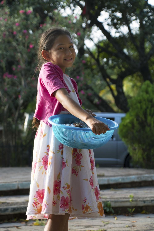 Shy smile, town square (El Mozote, El Salvador; Jul 2015)