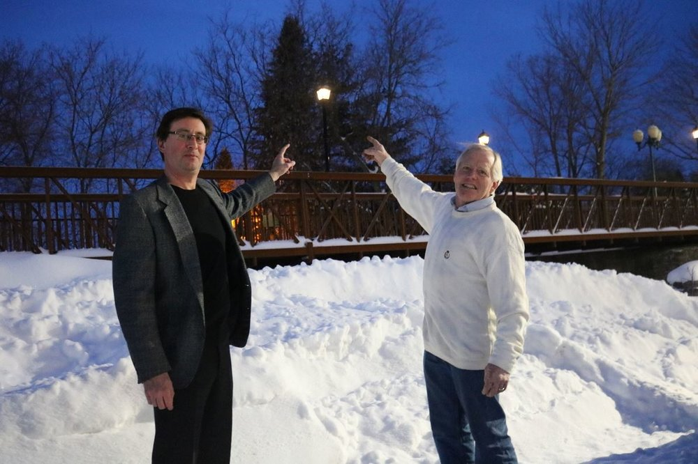 Ron Magen & John Dewitt point to one of the new solar powered lights - Photo by Andy Wheeler.