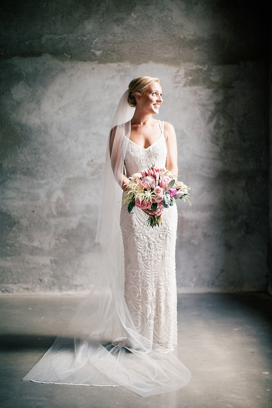 theia-couture-ivory-and-beau-bridal-boutique-savannah-wedding-dresses-savannah-bridal-gowns-savannah-wedding-gowns-savannah-bridal-beaded-wedding-dress-beaded-gown-.jpg