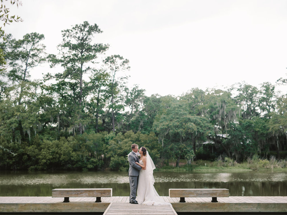 meagan-and-brenden-rach-loves-troy-photography-ivory-and-beau-bridal-boutqiue-ti-adora-wedding-dress-gold-lace-wedding-dress-savannah-wedding-planner-savannah-weddings-oldfield-plantation-wedding-savannah-florist-23.jpg