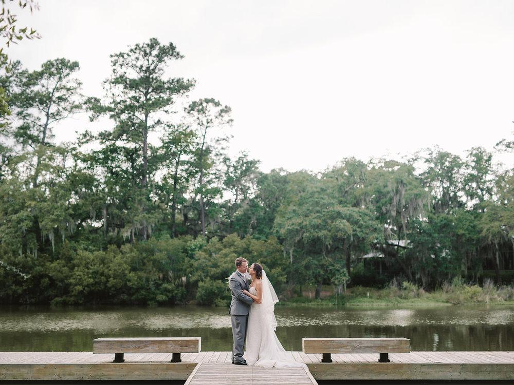 meagan-and-brenden-rach-loves-troy-photography-ivory-and-beau-bridal-boutqiue-ti-adora-wedding-dress-gold-lace-wedding-dress-savannah-wedding-planner-savannah-weddings-oldfield-plantation-wedding-savannah-florist-23.jpg