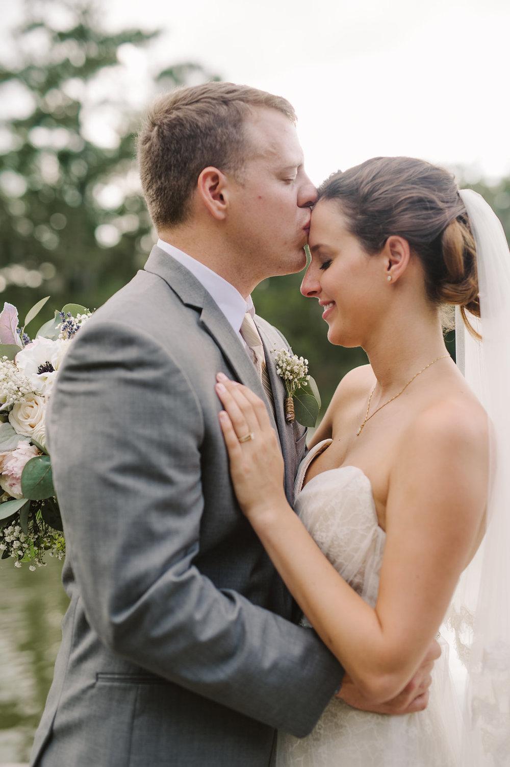 meagan-and-brenden-rach-loves-troy-photography-ivory-and-beau-bridal-boutqiue-ti-adora-wedding-dress-gold-lace-wedding-dress-savannah-wedding-planner-savannah-weddings-oldfield-plantation-wedding-savannah-florist-24.jpg