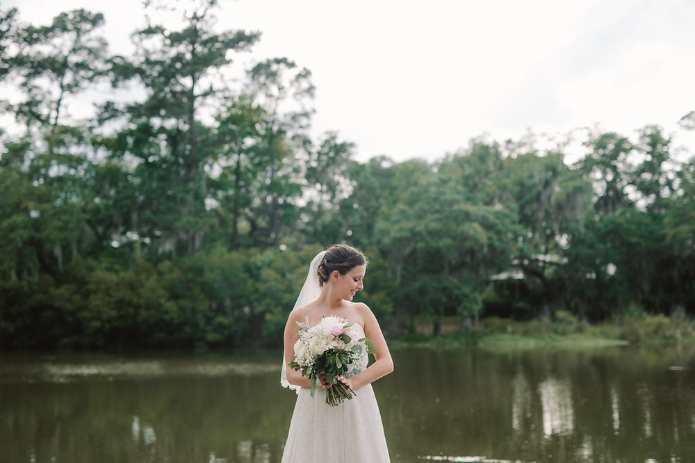 meagan-and-brenden-rach-loves-troy-photography-ivory-and-beau-bridal-boutqiue-ti-adora-wedding-dress-gold-lace-wedding-dress-savannah-wedding-planner-savannah-weddings-oldfield-plantation-wedding-savannah-florist-26.jpg