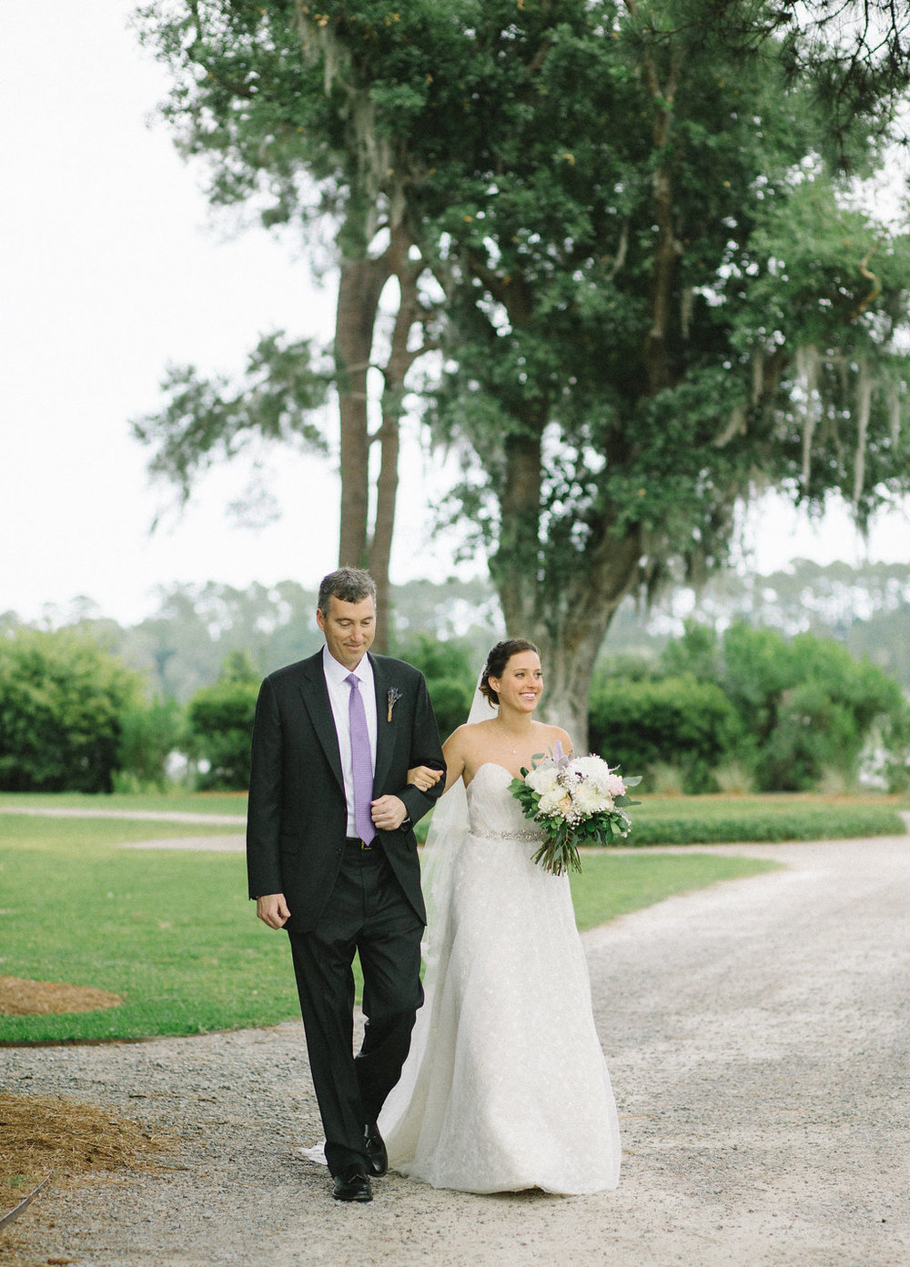 meagan-and-brenden-rach-loves-troy-photography-ivory-and-beau-bridal-boutqiue-ti-adora-wedding-dress-gold-lace-wedding-dress-savannah-wedding-planner-savannah-weddings-oldfield-plantation-wedding-savannah-florist-72.jpg