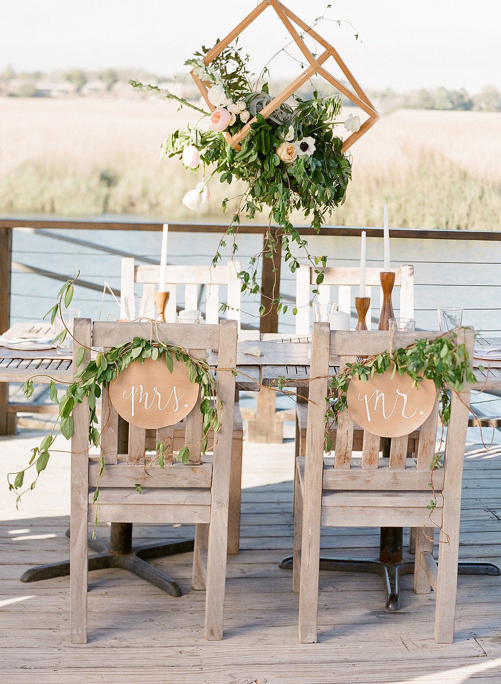 sweetheart-chairs-sweetheart-chair-leather-calligrapy-signs-ivory-and-beau-savannah-wedding-planner-hanging-centerpiece-savannah-wedding-florist-the-wyld-dock-bar-leather-wedding-inspiration-the-happy-bloom.jpg