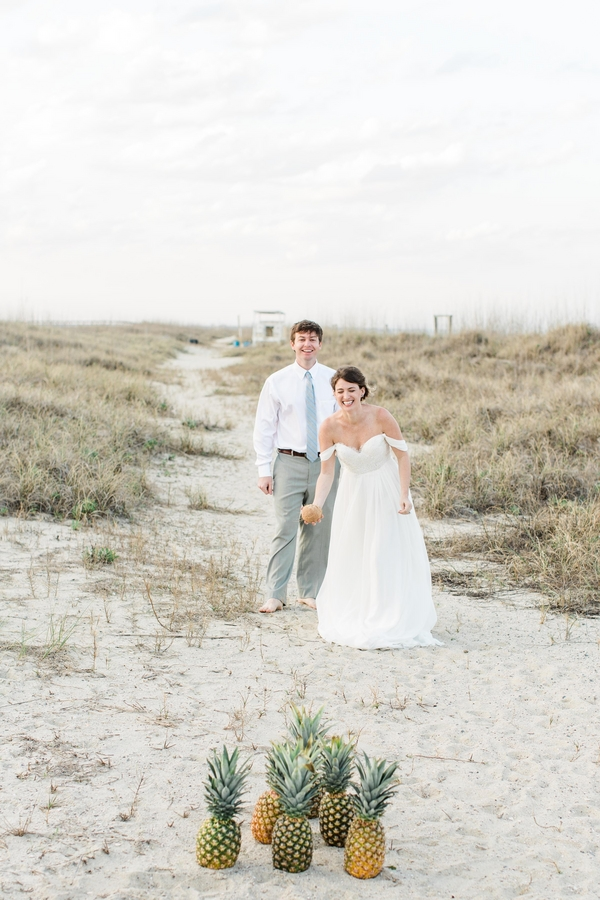 Pineapples on a beach and a Sarah Seven dress on  Southern Weddings . Need I say more? Love this playful summer shoot photographed by  Marianne Lucille .