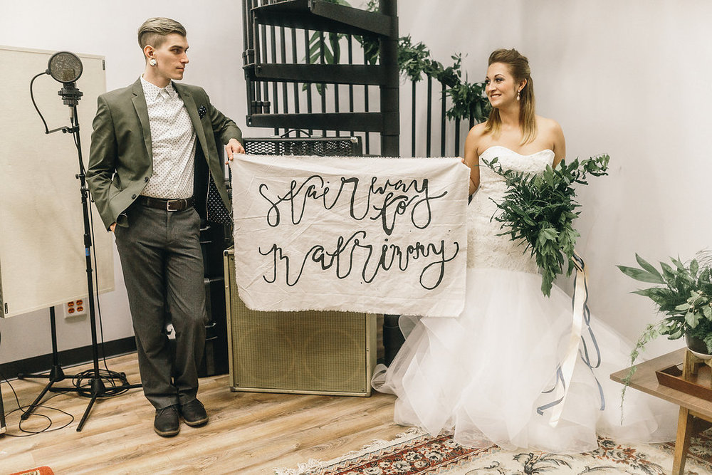 Stairway-to-Matrimony-mackensey-alexander-the-garage-savannah-ivory-and-beau-bridal-boutique-azi-blush-by-hayley-paige-indie-wedding-music-wedding-recording-studio-wedding-savannah-wedding-planner-savannah-florist-savannah-bridal-gowns-3.jpg