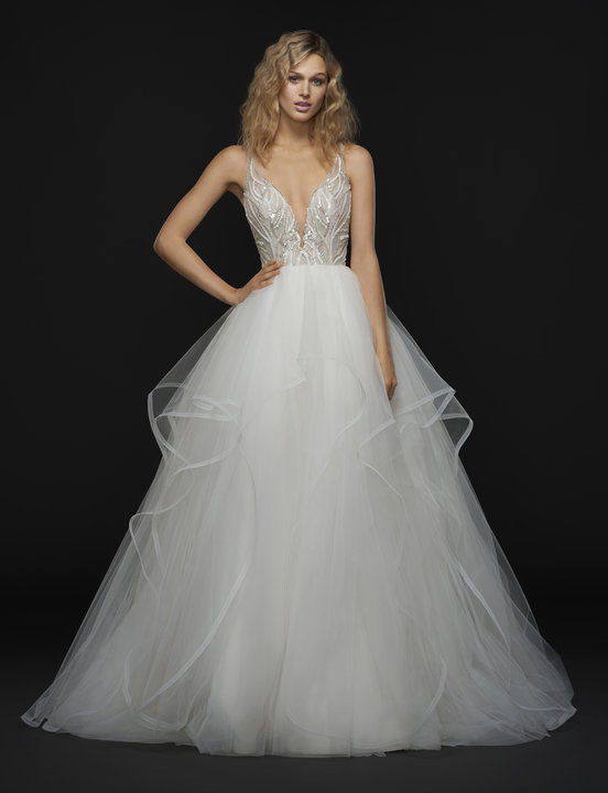 Meet Lincoln: for that sexy sophisticated glam that only happens when Hayley Paige makes magic. The unique beaded top is romantic yet still sexy and the ballgown silhouette makes momma happy. This gown is a jaw-dropping beauty and the thin horsehair trim of the skirt makes it move like an angel.