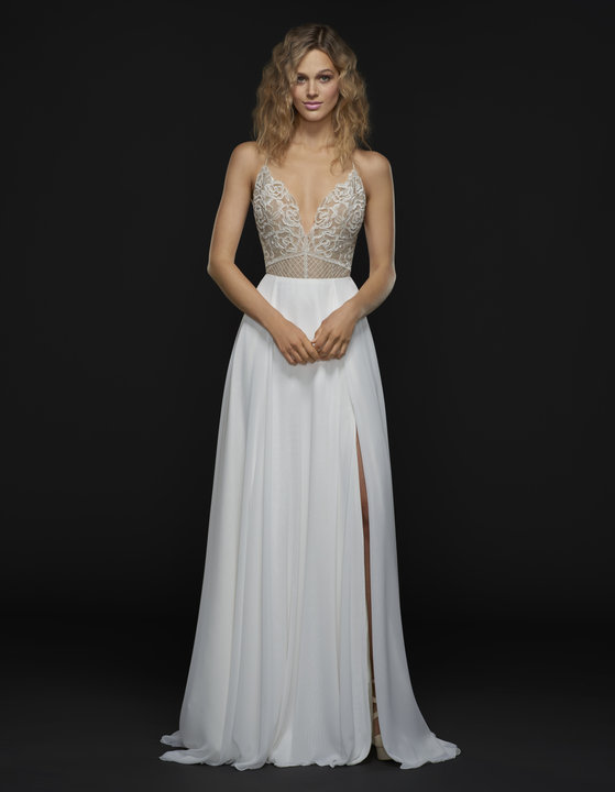 Meet Daria: while the name might bring up memories of that old MTV cartoon in the 90s... the Daria gown brings up images of an ethereal bride floating on clouds on a sunny day in Georgia. With a sweet beaded embellishment over nude lining the dress is a touch sexy while still giving the bride that dreamy-floating-on-air sort of look.