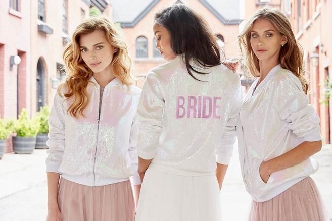 bomberjacket-hayley-paige-sparkle-athleisure-hologram-bride-bomber-jacket-ivory-and-beau-savannah-bridal-boutique-savannah-wedding-dresses-savannah-bridal-shop-blush-by-hayley-paige.jpg