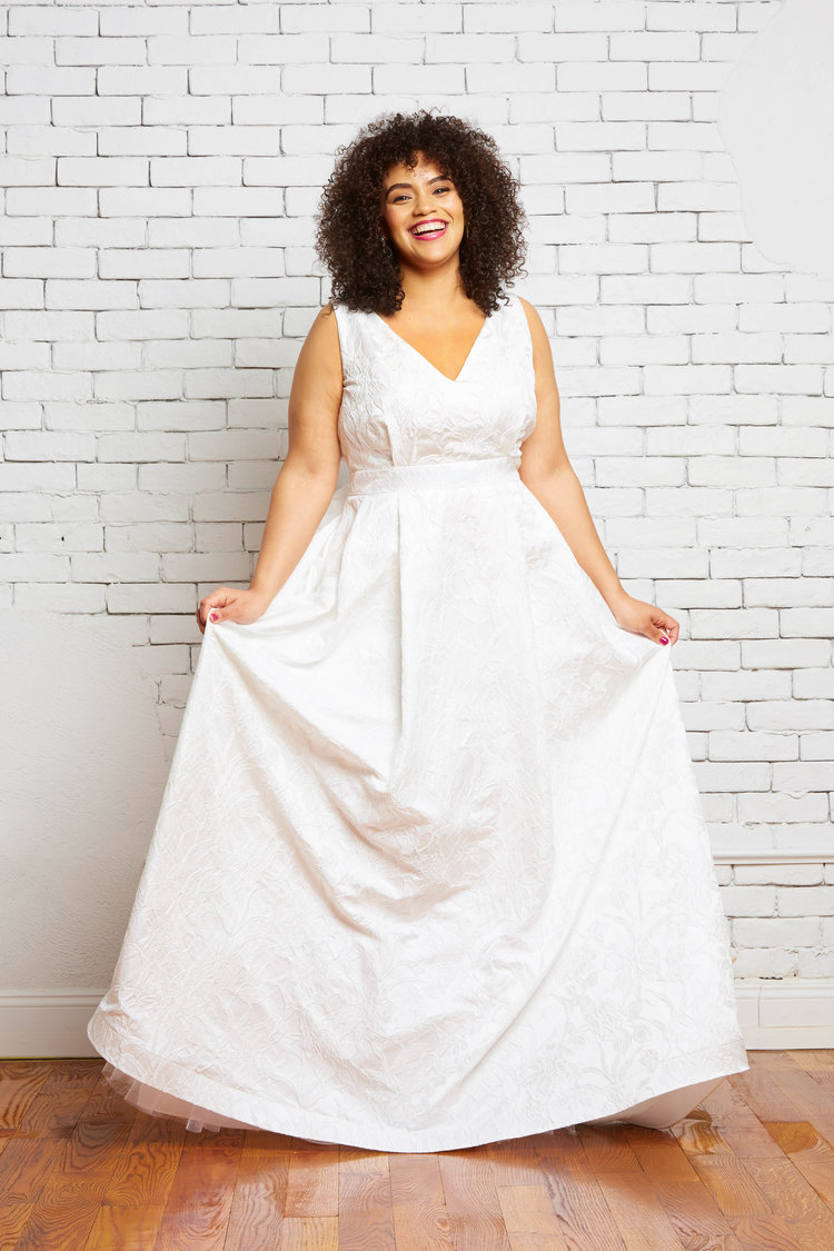 With this blog post I had to highlight our Rebecca Schoneveld collection, Women of All Sizes. This stunning collection is designed in NYC and this designer is all about inclusivity of all sizes. Her designs are for brides of a petite size to a plus size and all the in-betweens. Every women should feel beautiful as a bride and every women should have options when shopping for their wedding dress, the most important garment they will ever wear. You can read/see more about Rebecca Schoneveld's message of inclusivity  here !    Some shops carry only sample sizes 10-12's... at Ivory & Beau we carry all sizes from 8's to 26's. With every market we pay close attention to our current sample sizes and styles available so that we can add more sizes and varieties of styles to our shop for our brides. We believe it is important to have options for all sizes to feel and look their absolute best and this is part of our mission. We want to be able to offer every size woman a dress in every bridal shape/style (mermaid, sheath, a-line, ballgown). We understand that every bride is going to have some sort of insecurity because you know what... so do each and every one of us who work at this small business. We work hard to be knowledgable about our styles so that we know how we can customize them in ways our brides want so they can feel (not just look but really feel deep down) beautiful.