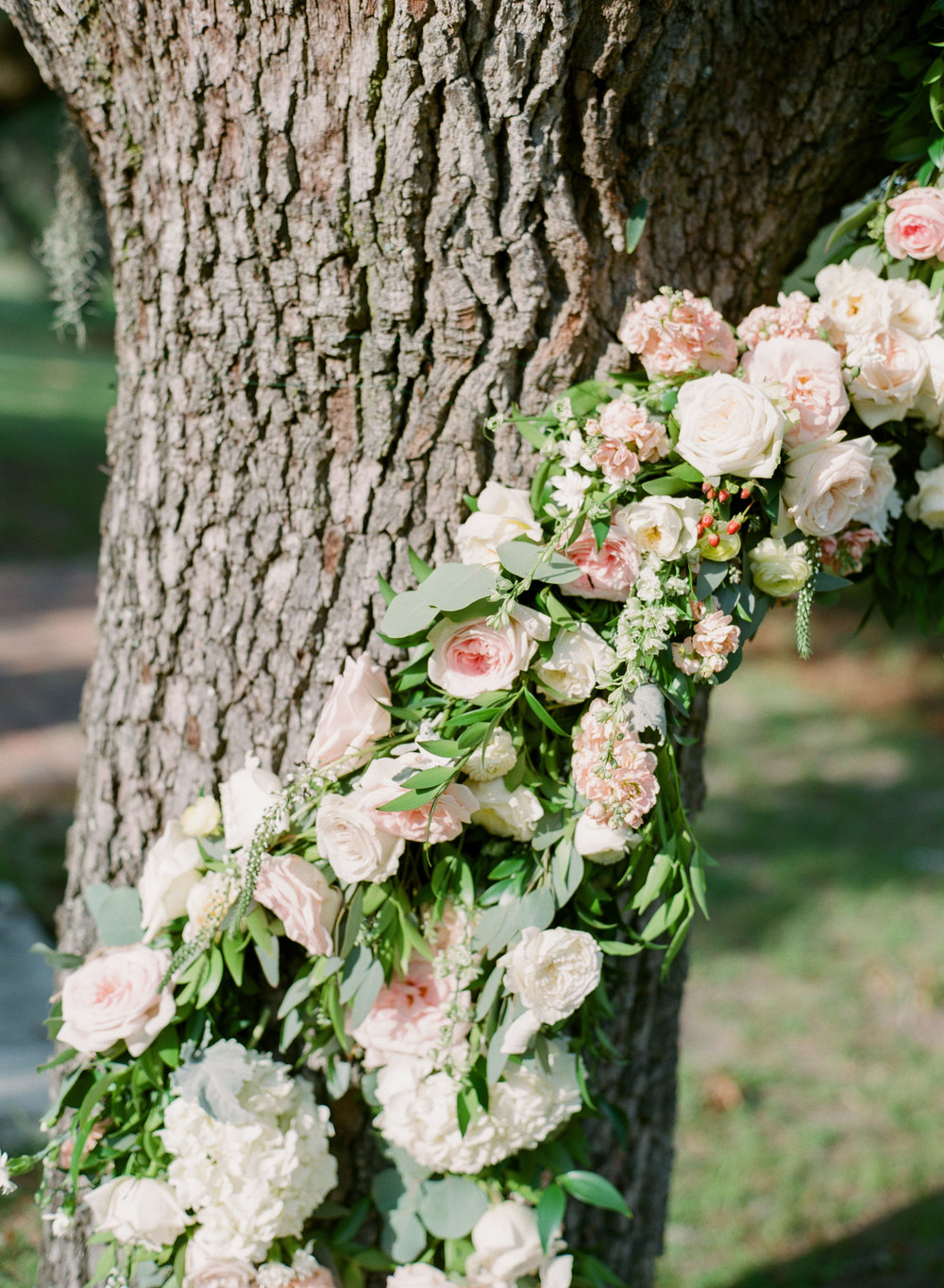 Floral Tree Magic - A floral tree installation is something I've dreamt of for years and bringing it to life with a color palette of the softest blushes and yellows with miles of greenery felt like something straight out of a fairytale.Photography:The Happy BloomLocation:BethesdaDress:Blush by Hayley Paige