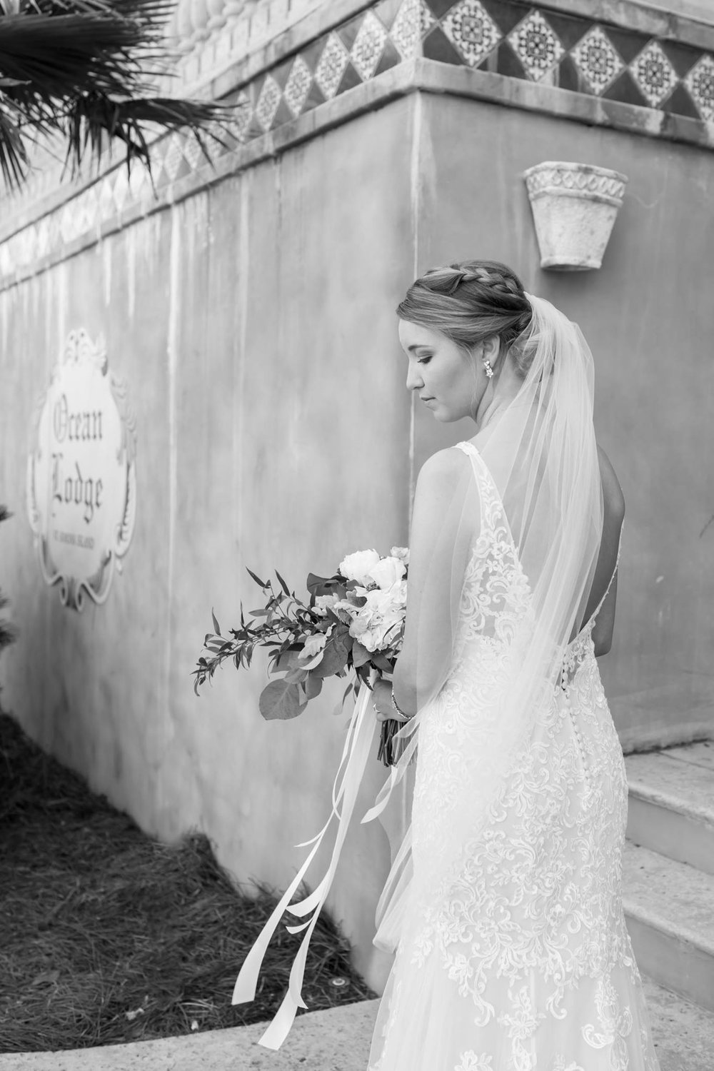ivory-and-beau-bridal-boutique-savannah-bridal-boutique-rainey-gregg-photography-tara-by-rebecca-ingram-Couffia-Couture-veil-the-rooftop-at-ocean-lounge-saint-simons-island-wedding-9.jpg