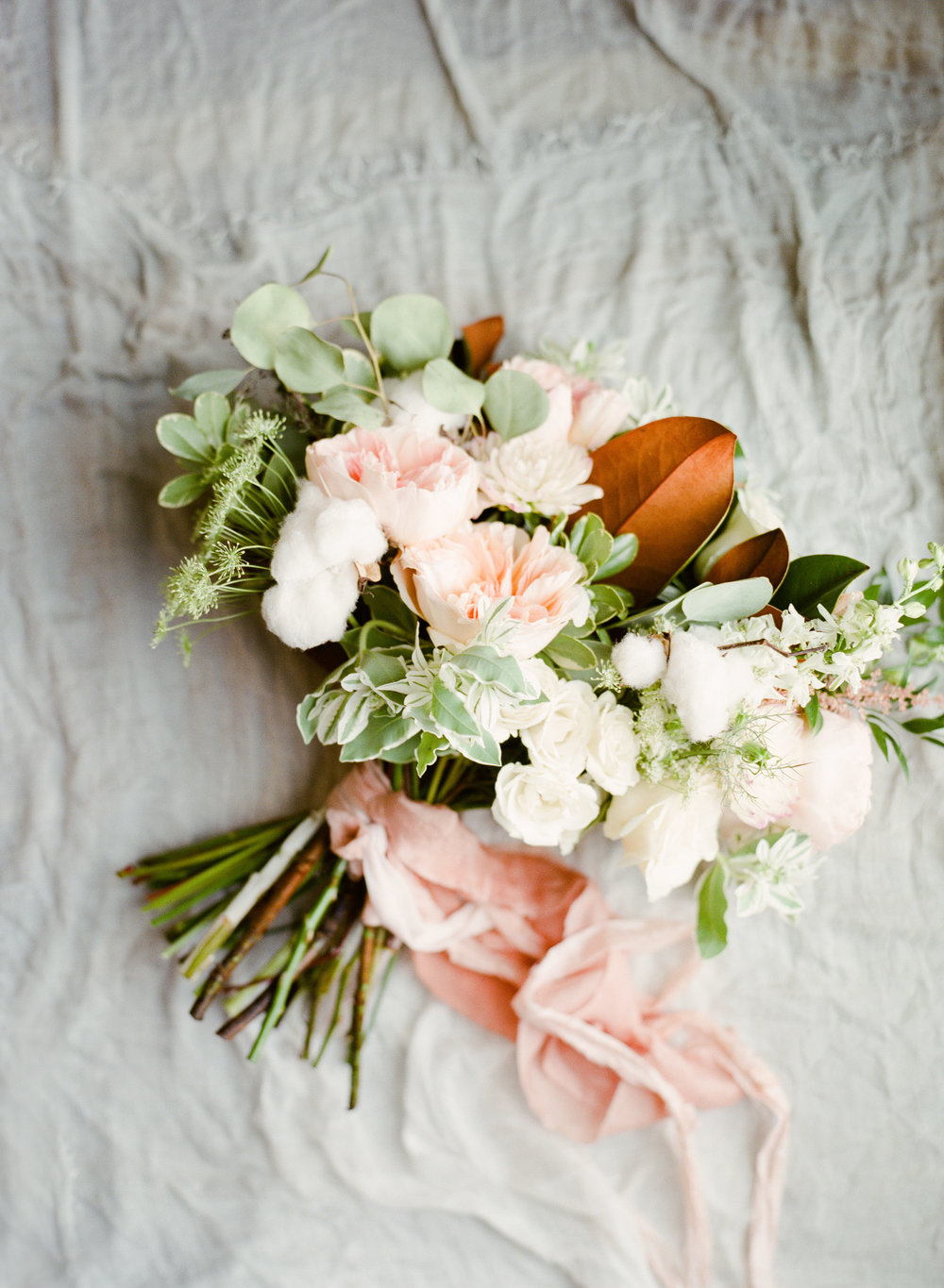 Kylie + Johnathan - Cotton bolls, soft pale blush blooms, lush greenery with pops of magnolia greenery made up this Southern dreamy wedding in the heart of Savannah.Photography: The Happy BloomLocation: Cha BellaI&B: Month-of Coordination + flowersSee more on our blog and Lowcountry Wedding Magazine!