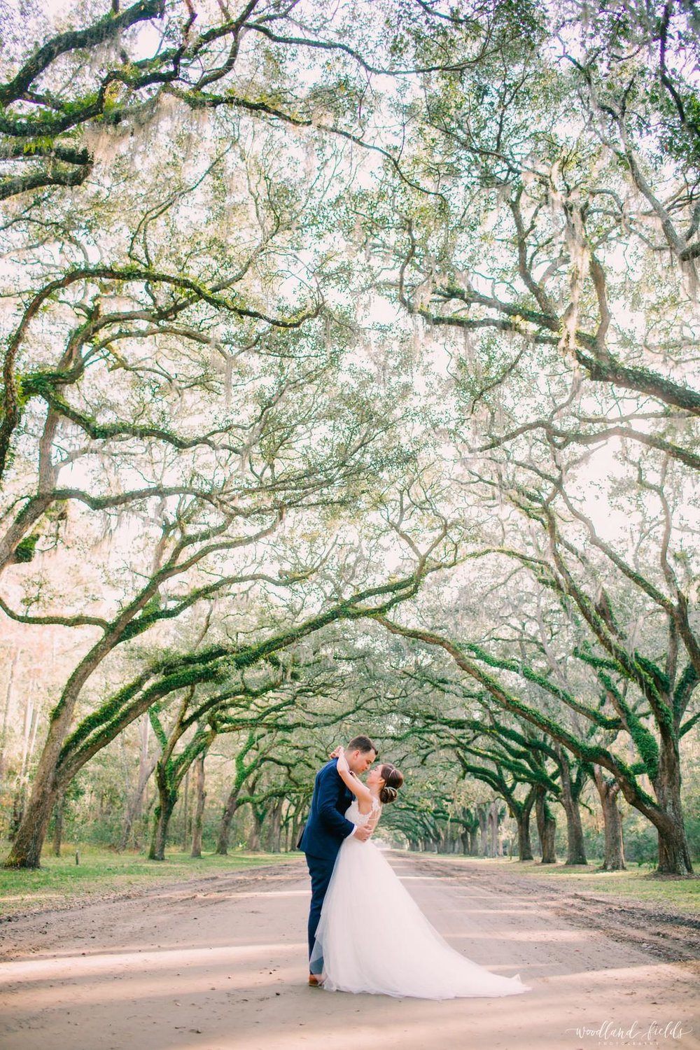savannah-bridal-shop-ivory-and-beau-bridal-boutique-beth-and-jesse-woodland-fields-photography-georgia-railroad-museum-wedding-7.jpg