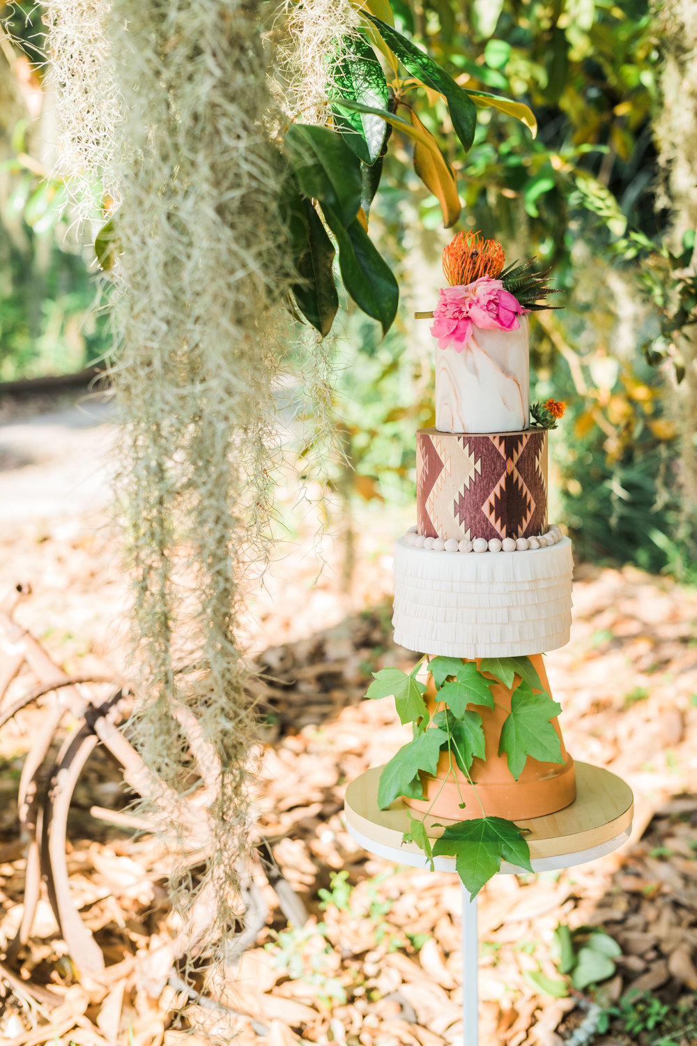 southwestern-wedding-cake-ivory-and-beau-savannah-wedding-planner-savannah-event-designer-savannah-wedding-cakes-the-topiary-alpaca-wedding-bud-johnson-photography-savannah-baker-savannah-unique-weddings-savannah-creative-wedding-inspiration.jpg