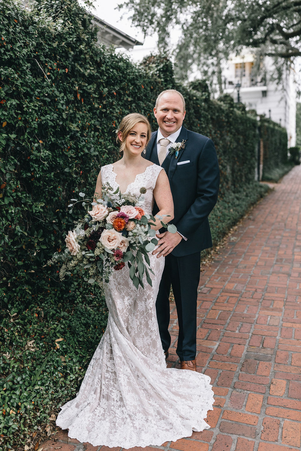 ivory_and_beau_savannah_bridal_shop_ivory_and_beau_couple_regan_and_brian_mackensey_alexander_photography_charles_h_morris_center_wedding_savannah_wedding_planner_savannah_florist_16.jpg