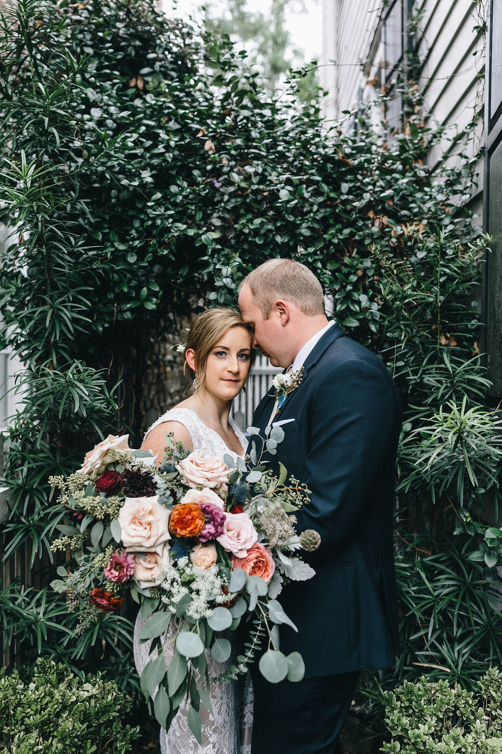 ivory_and_beau_savannah_bridal_shop_ivory_and_beau_couple_regan_and_brian_mackensey_alexander_photography_charles_h_morris_center_wedding_savannah_wedding_planner_savannah_florist_18.jpg