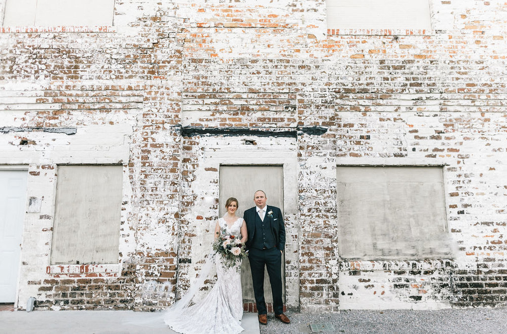 ivory_and_beau_savannah_bridal_shop_ivory_and_beau_couple_regan_and_brian_mackensey_alexander_photography_charles_h_morris_center_wedding_savannah_wedding_planner_savannah_florist_38.jpg