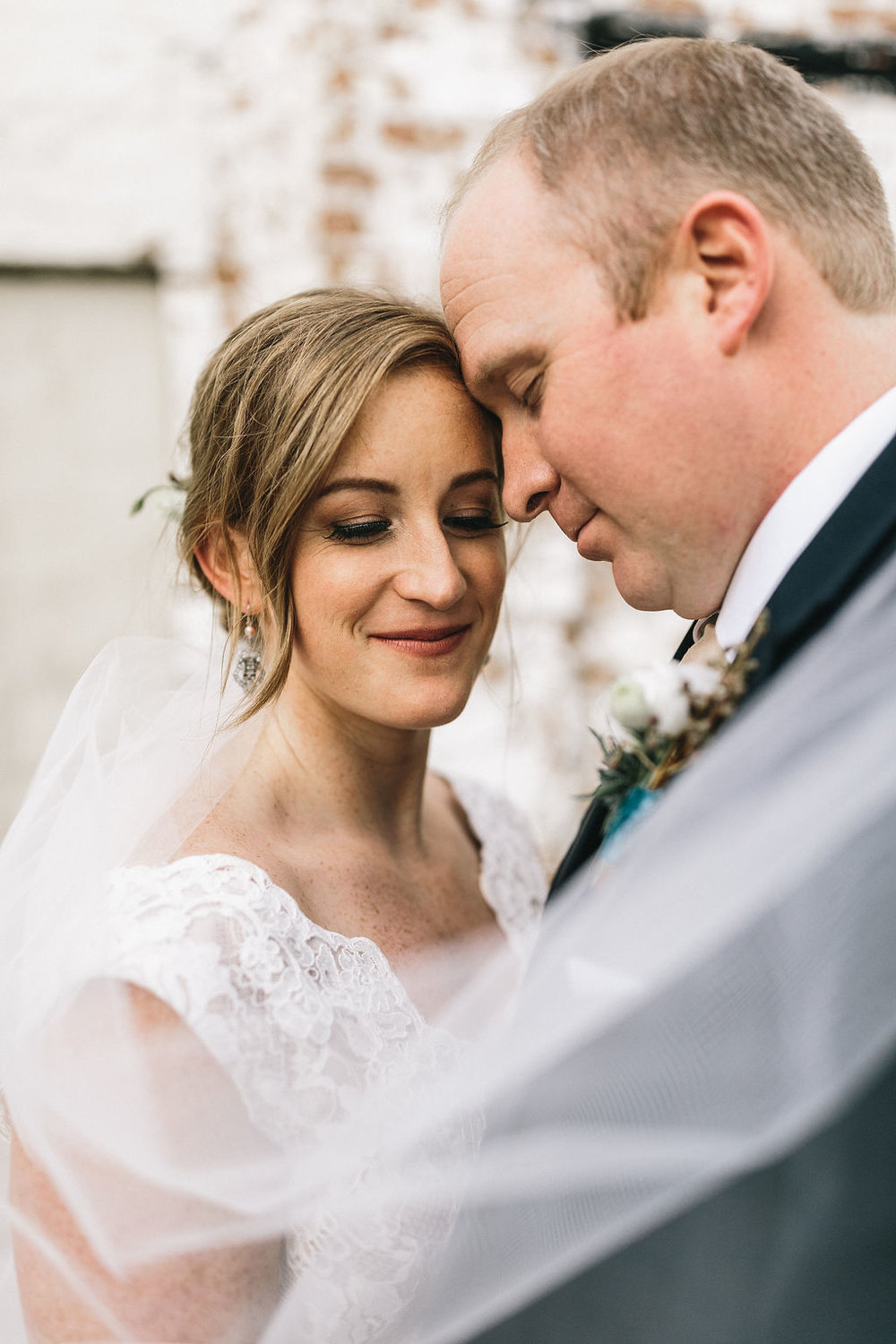 ivory_and_beau_savannah_bridal_shop_ivory_and_beau_couple_regan_and_brian_mackensey_alexander_photography_charles_h_morris_center_wedding_savannah_wedding_planner_savannah_florist_39.jpg