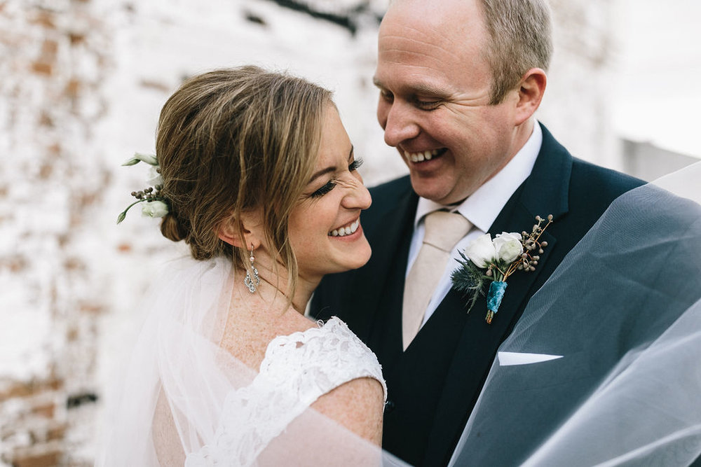 ivory_and_beau_savannah_bridal_shop_ivory_and_beau_couple_regan_and_brian_mackensey_alexander_photography_charles_h_morris_center_wedding_savannah_wedding_planner_savannah_florist_40.jpg