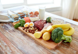 stock-photo-balanced-diet-cooking-culinary-and-food-concept-close-up-of-vegetables-fruit-and-meat-on-304751963.jpg